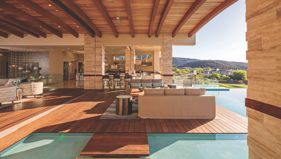 An outdoor living space by Sun West Custom Homes that includes transition zones and water elements