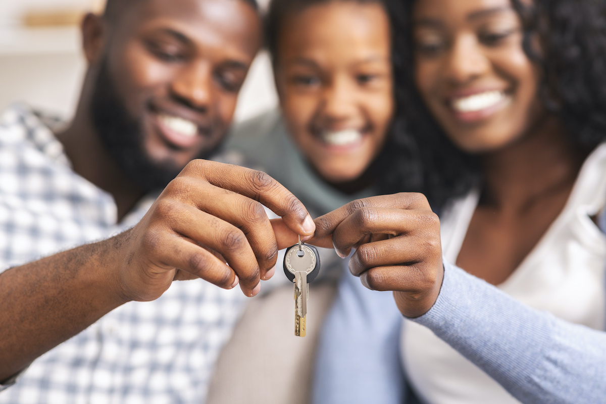 Family holding up house key