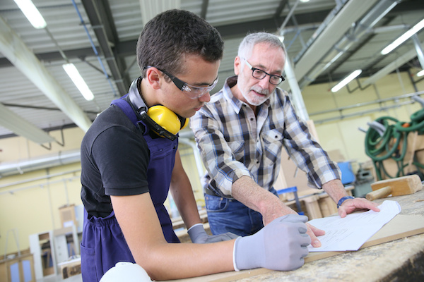 Student being taught construction trades in workshop