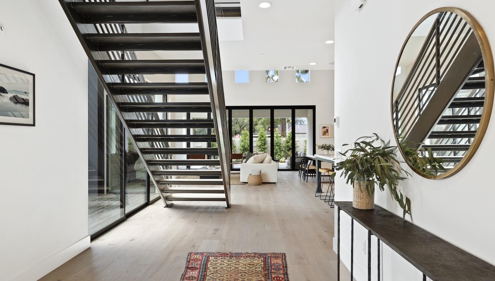 Dahlin Group's Miraval II Plan 2 interior stair with abundant natural light