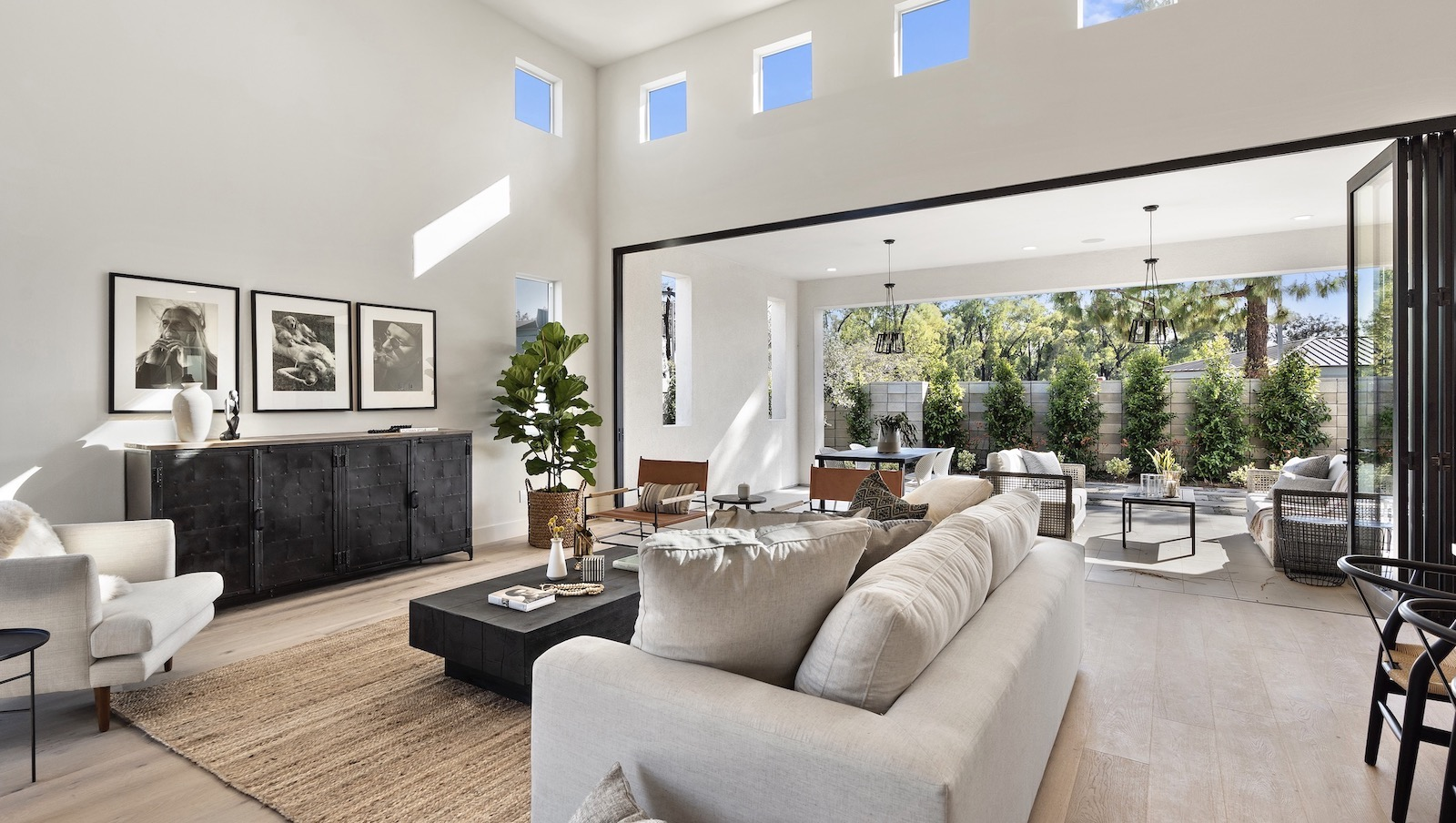 Dahlin Group's Miraval II Plan 2 great room with view to outdoor living