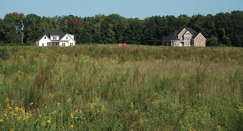 Undeveloped open fields waiting for acquisition by builders