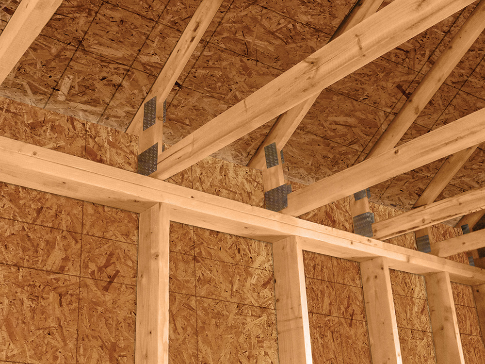 New guide for building with raised heel trusses pro builder for Pre engineered roof trusses