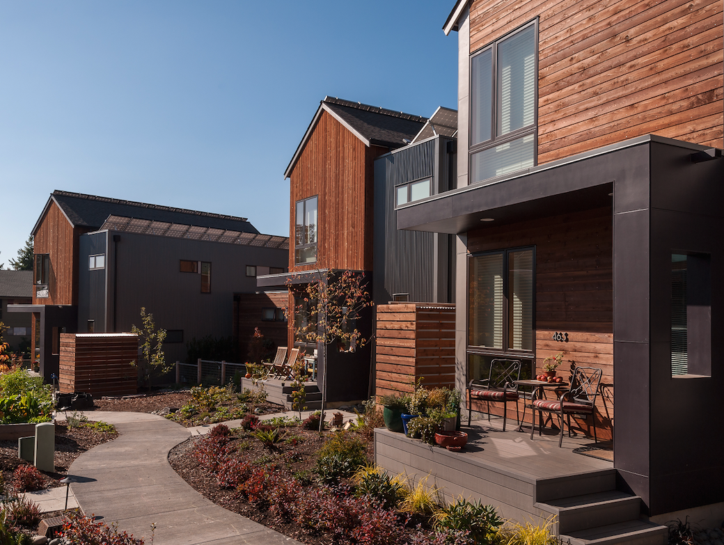 The homes at Grow have a modern architectural style, with forms reminiscent of farm buildings