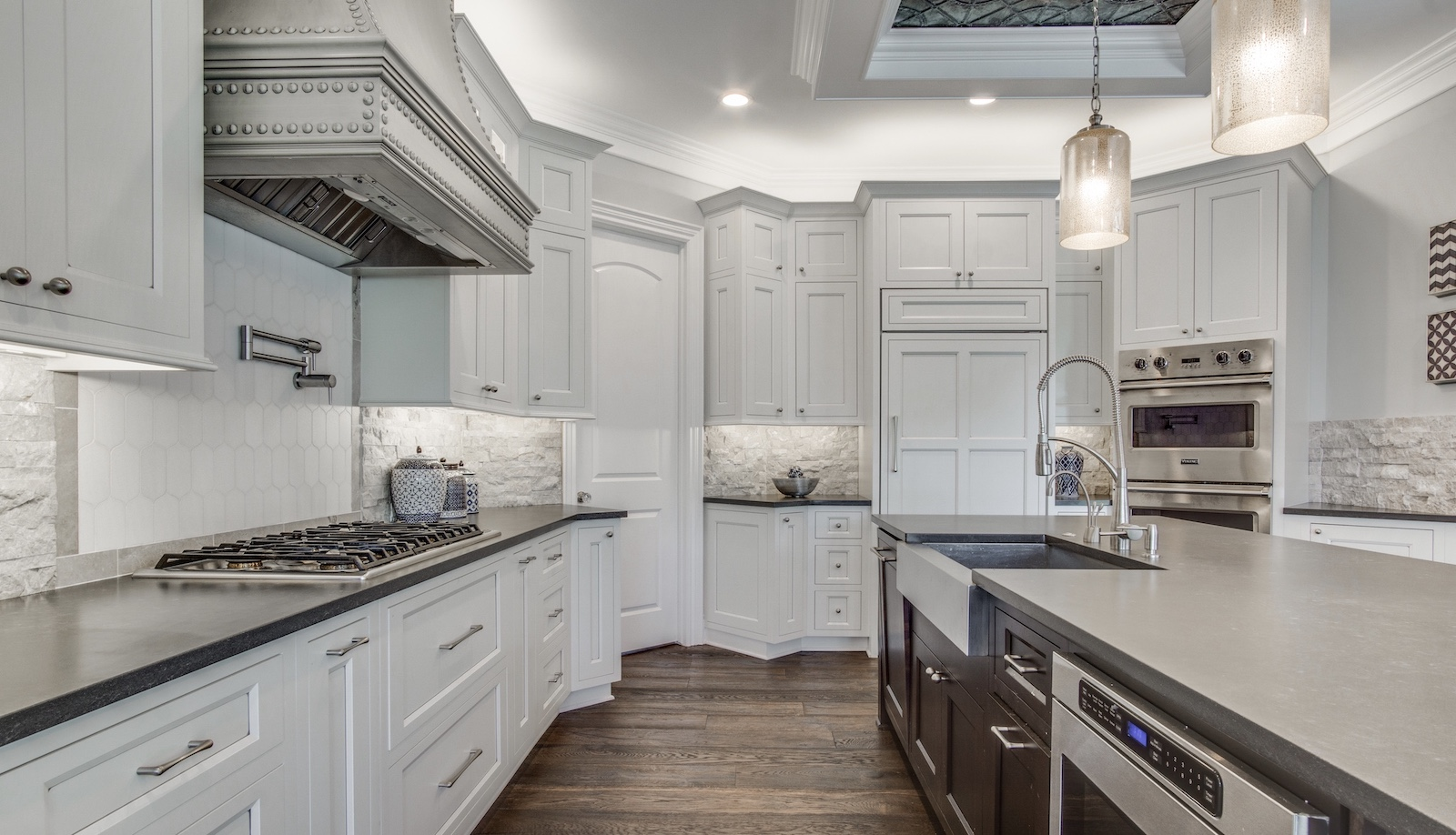 The kitchen island and range hood in Jaime, designed by TK Design & Associates