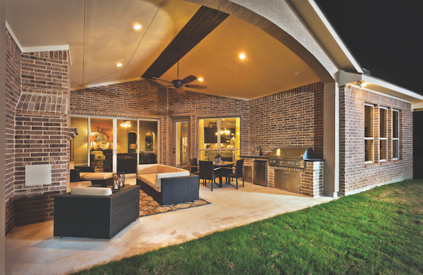 A Model Home At Valencia Park In San Antonio, Texas, Has A Covered Outdoor  Porch With A Fireplace, Dining And Seating Areas, And A Built In Kitchen.