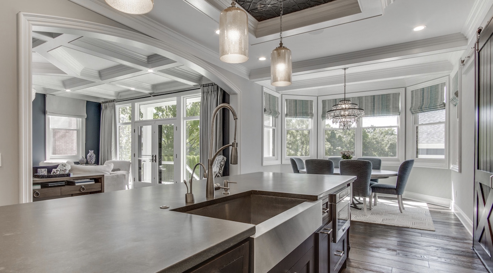 View from the kitchen to the dining area in Jaime, designed by TK Design & Associates