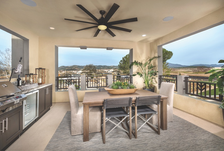 Covered roof deck with outdoor kitchen and openings that frame views