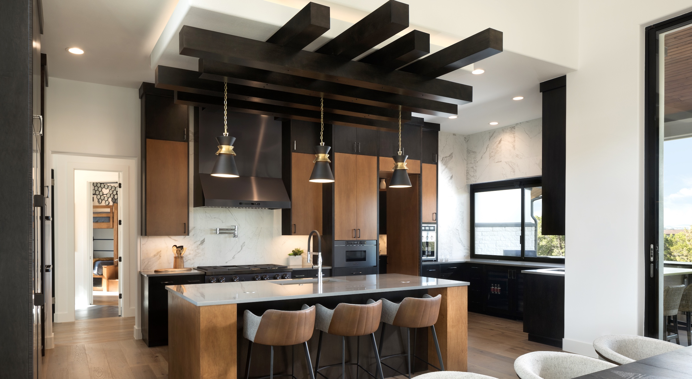 Black and wood in the kitchen with a custom treatment for the ceiling
