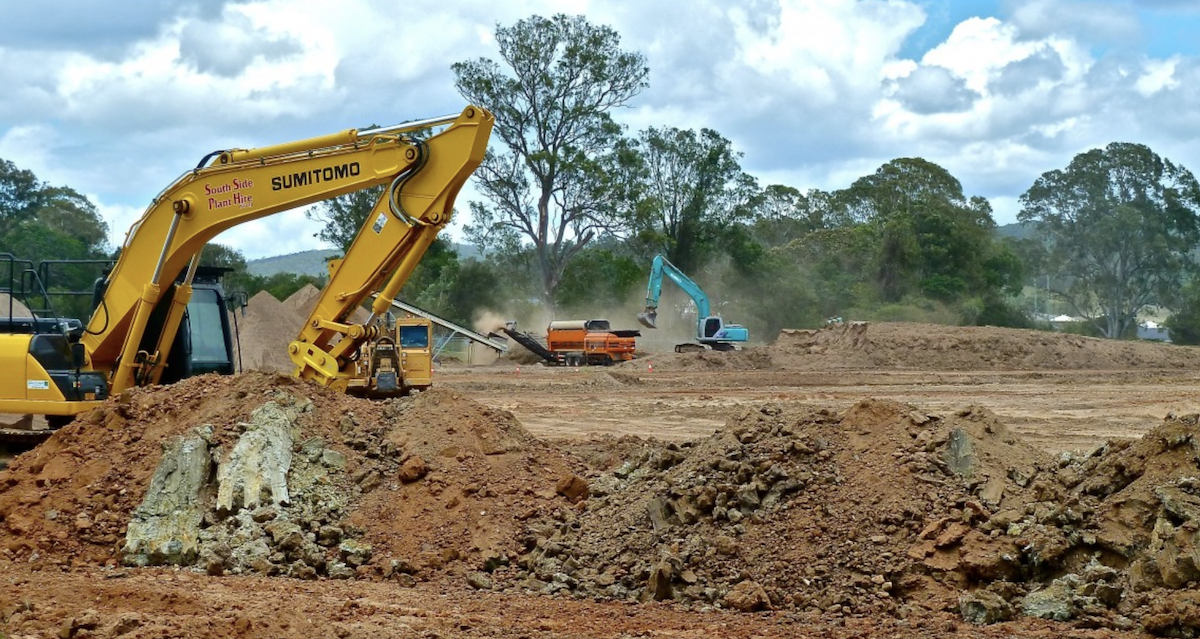 heavy machinery clearing land for home building