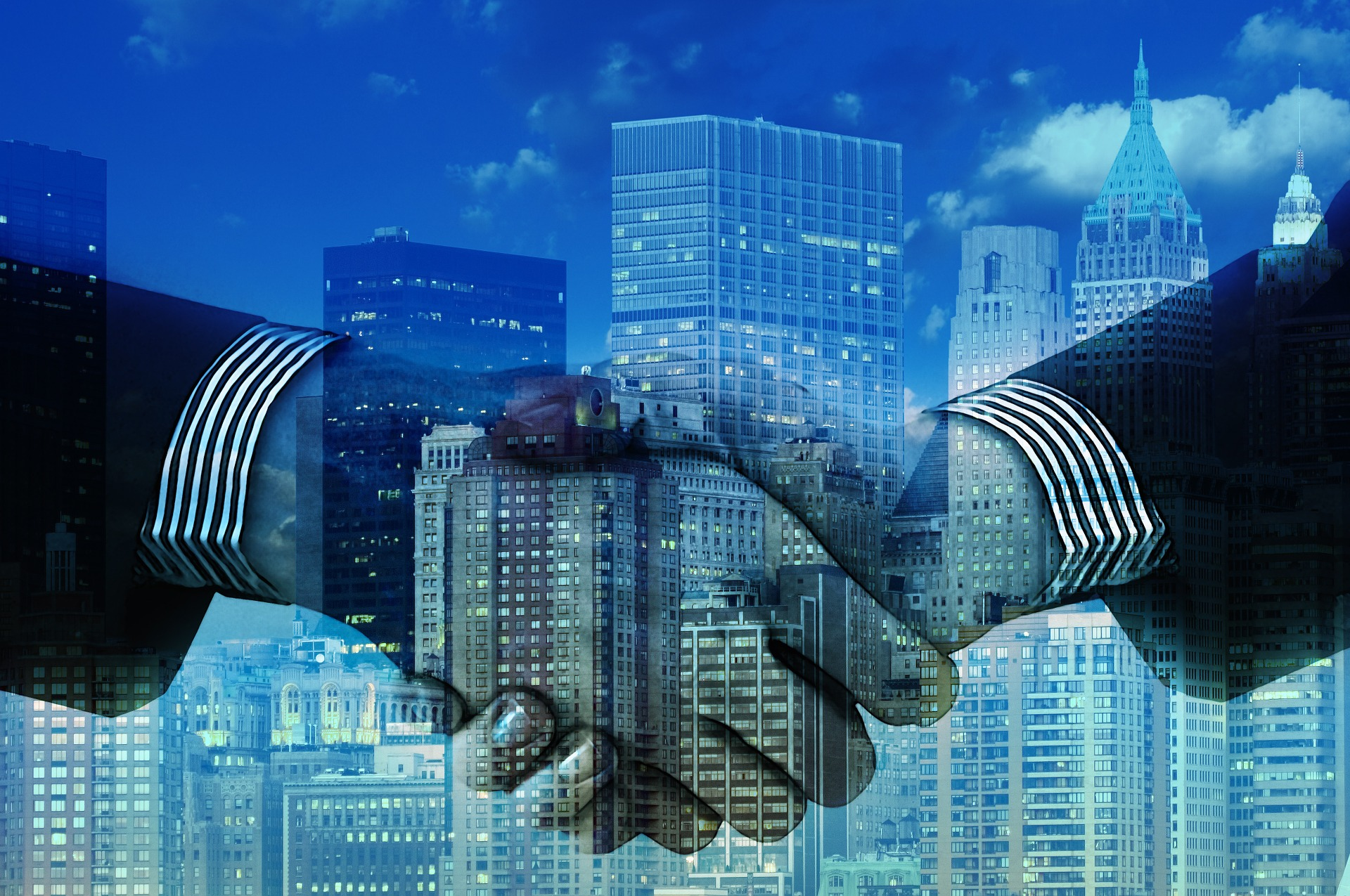 a company merger handshake for a business deal