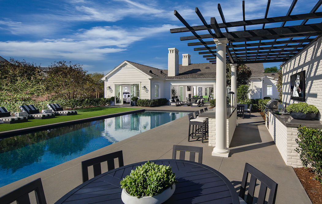 New Home Company Sky Ranch outdoor living with pool and pergola