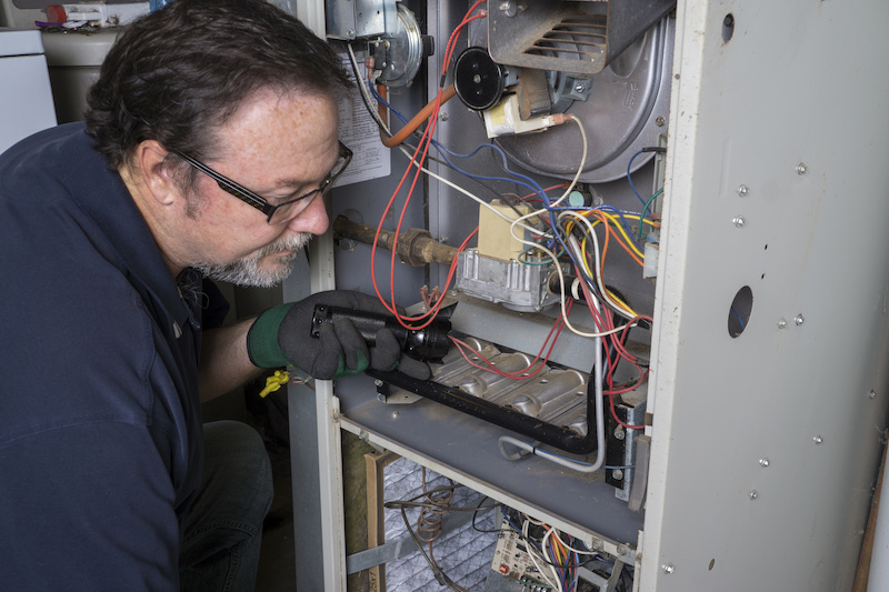 HVAC contractor working on installing home HVAC system