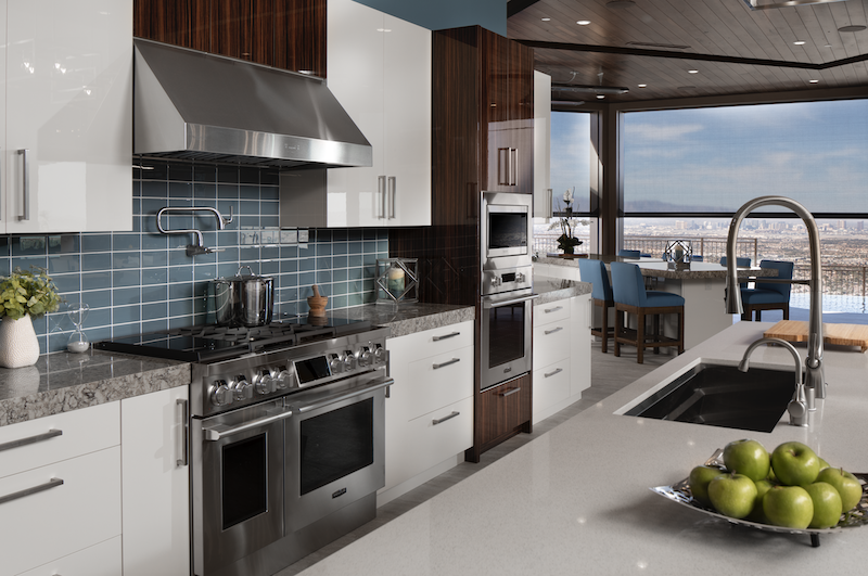 The New American Home kitchen with wet bar and adjoining dining area