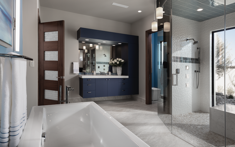The New American Home master bath with floating vanity and blue color scheme