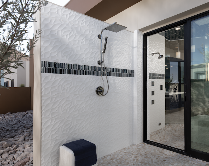 The New American Home outdoor shower with glass sliding door
