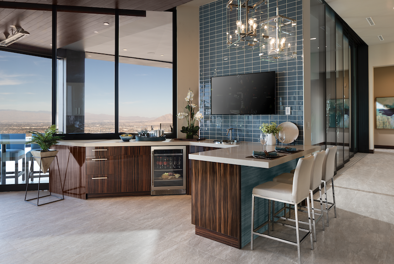 The New American Home wet bar with TV and Las Vegas views