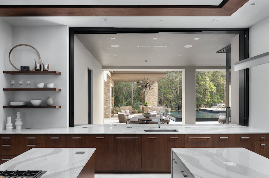 Nyumbani luxury spec home view from kitchen to outdoor entertaining area