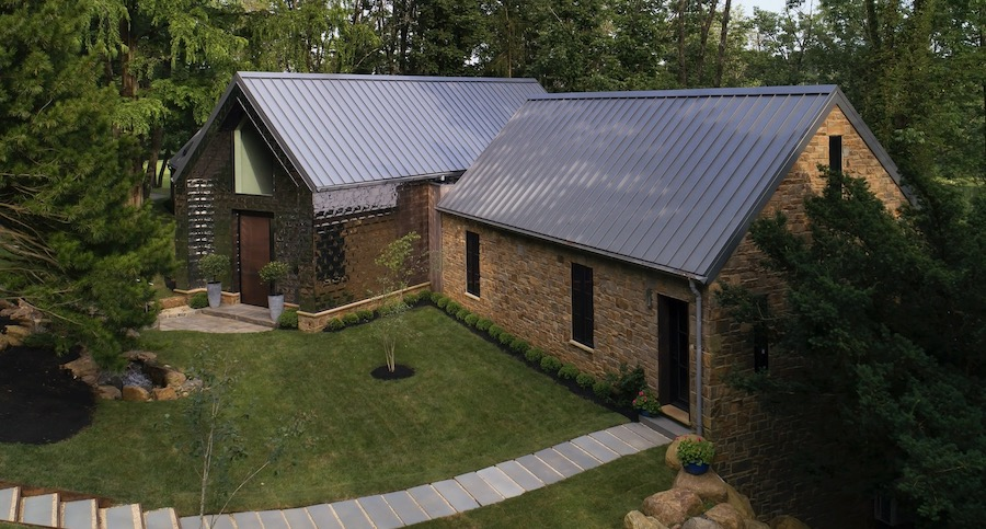 Petersen's Pac-Clad Precision Series metal roof (Diamond) attached to the walls of a house