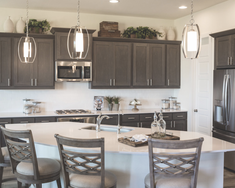 in Trendmaker Homes' design at Rancho Sienna, the kitchen offers Texas Hill Country charm