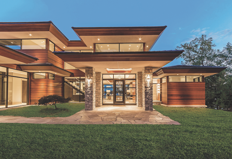 exterior view of Windsor Windows & Doors products installed in a contemporary-style house