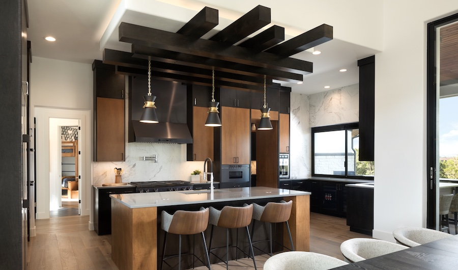 Wood tones with black provide texture and drama in this kitchen