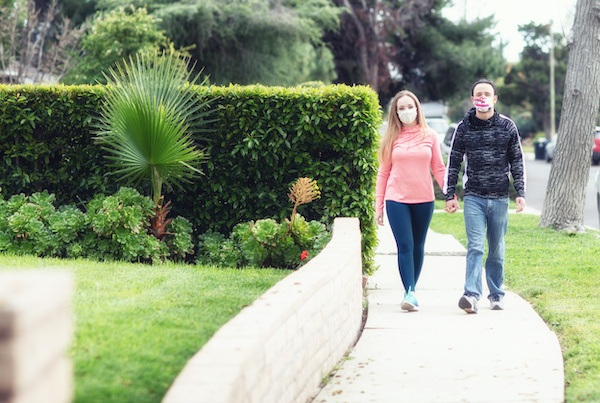 Couple Walking in suburbs