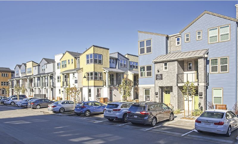 street view of exterior infill housing development Nova at the Vale, yellow-blue-gray color scheme