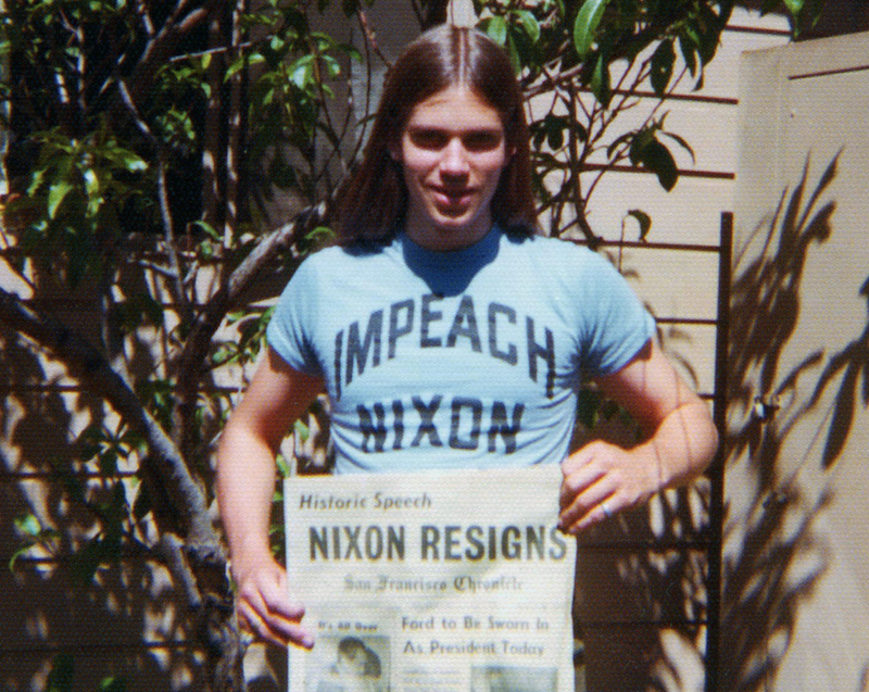 young man wearing Impeach Nixon T-shirt and holding SF Chronicle newspaper with Nixon headline