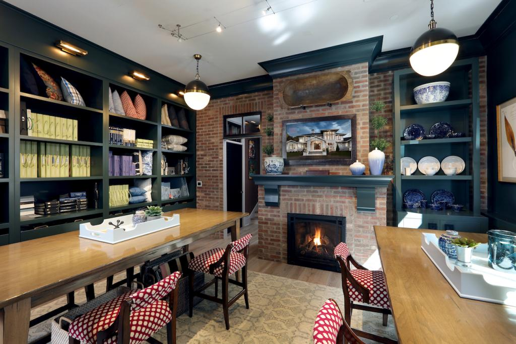 A Napoleon STARfire fireplace with traditional brick surround welcomes clients into a flexible work space on the main level.