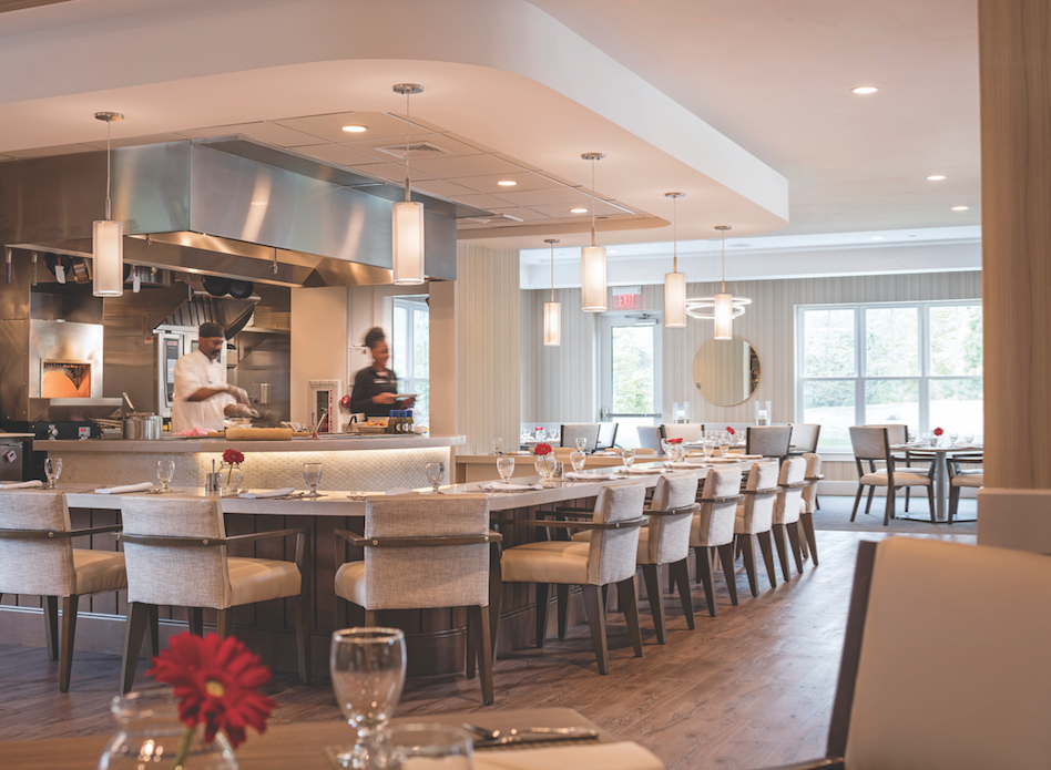 In many senior living facilities, the restaurant area is an important gathering place. At One Wingate Way, in Needham, Mass., an independent living facility by The Architectural Team, the bistro and outdoor patio are linked to the adjacent assisted living project.