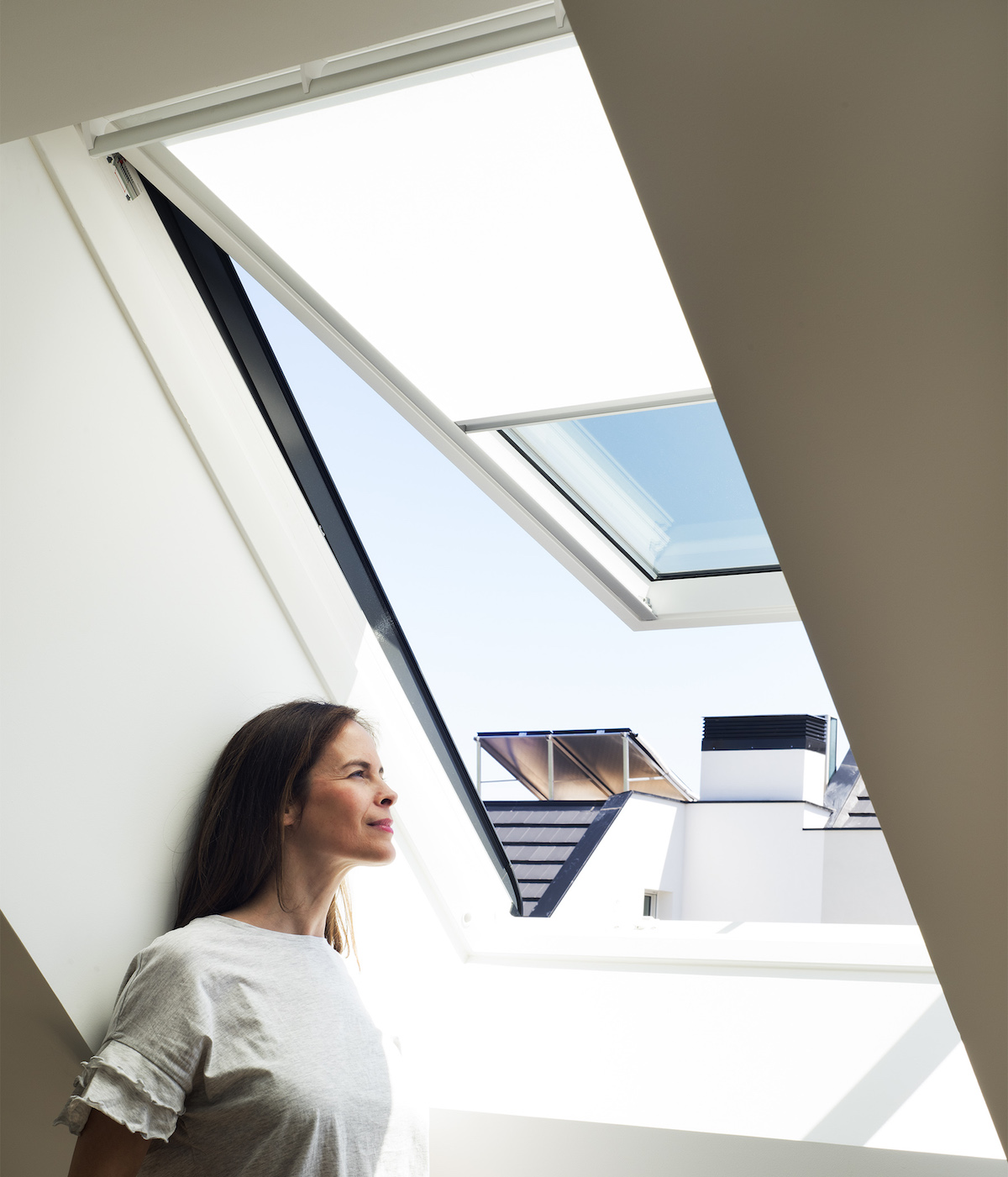 Velux GPL roof window admits natural light and fresh air while maximizing outdoor views