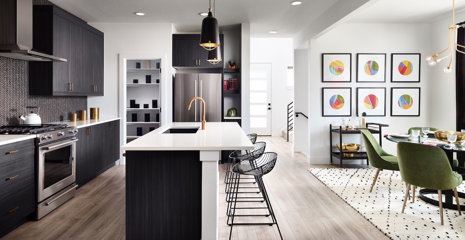Sleek kitchen with black and white details.