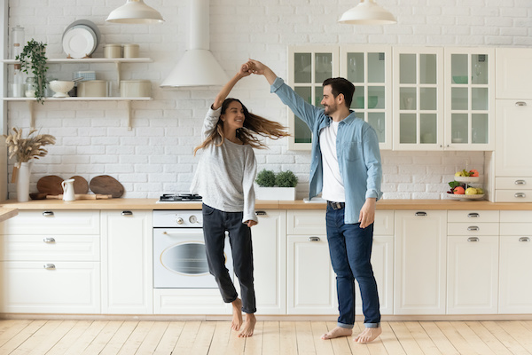 New homeowners dancing