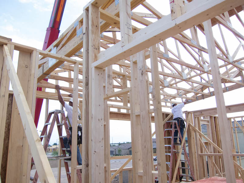 construction workers framing house during labor shortage
