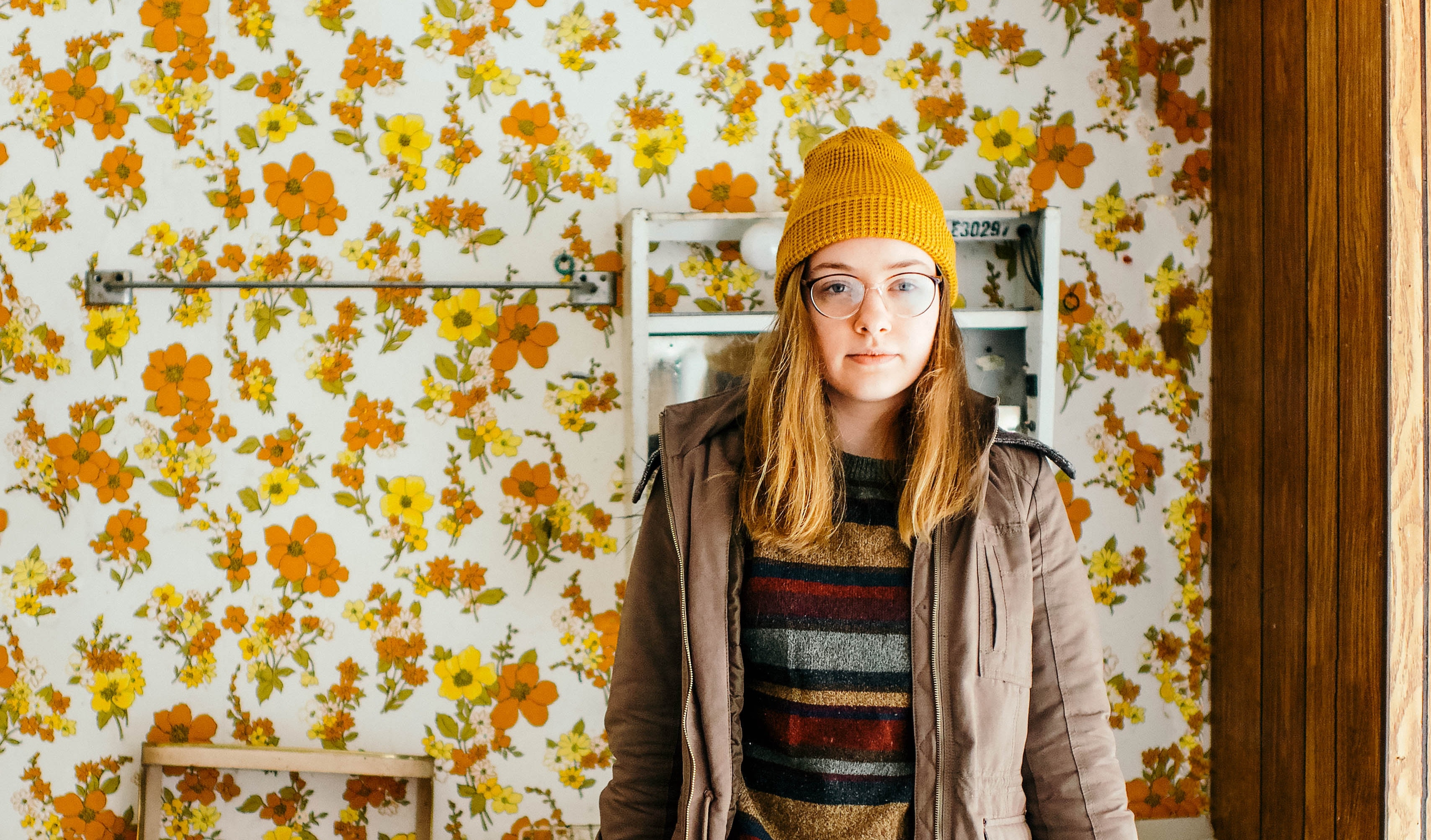 Woman standing in bathroom with '70s décor
