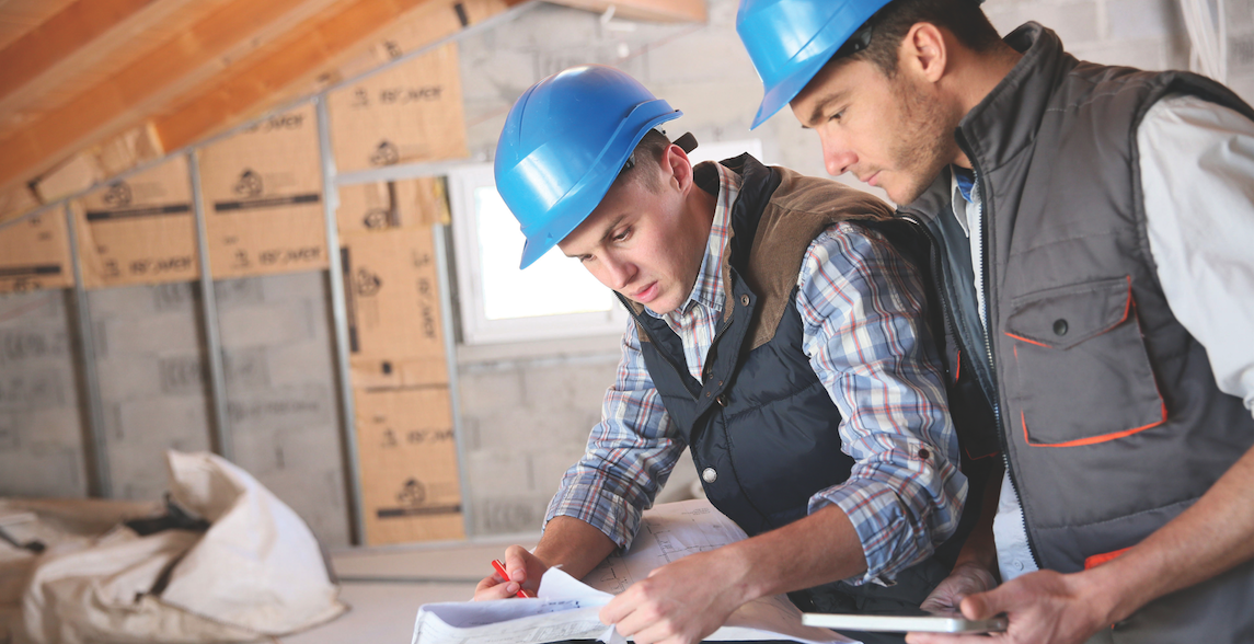 architect and engineer on jobsite check house plan