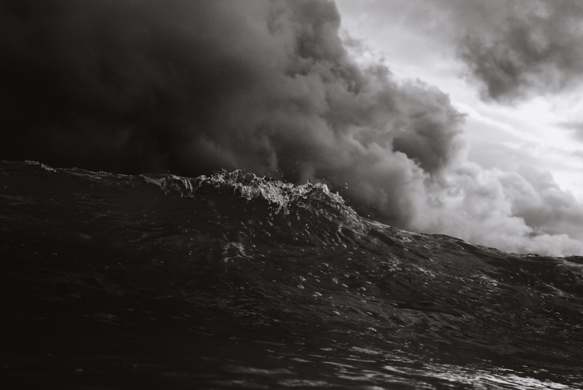stormy ocean waves with gathering clouds overhead