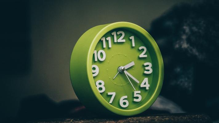 Green clock on table