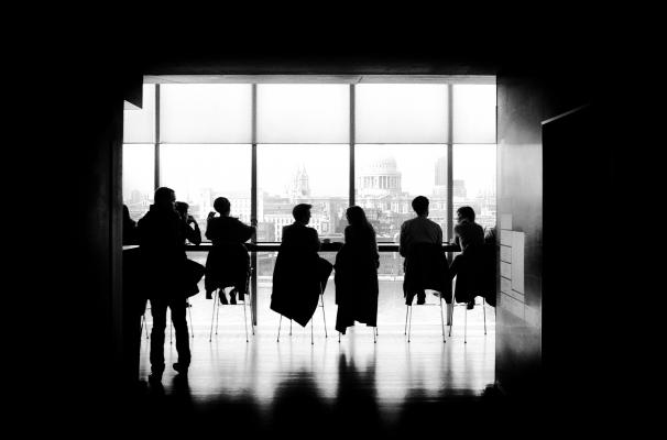 Boardroom with people in it black and white