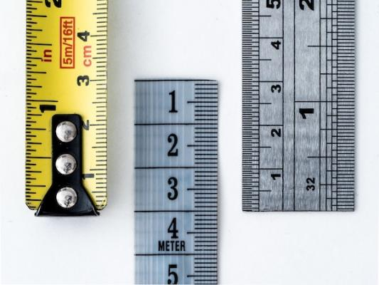 Three measuring tapes for measuring home size
