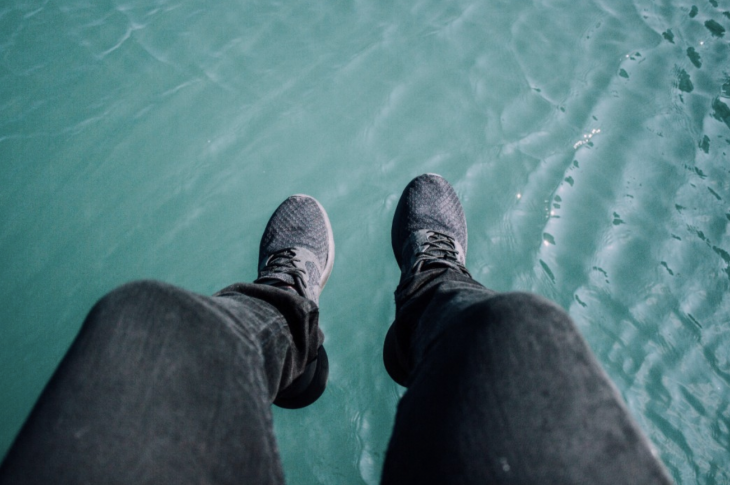 feet suspended over water