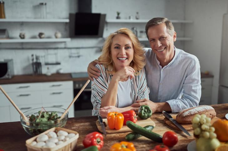 55 year old couple happy in the kitchen