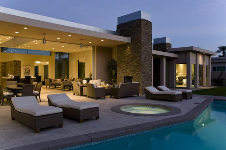 Backyard of a luxury home with pool and jacuzzi