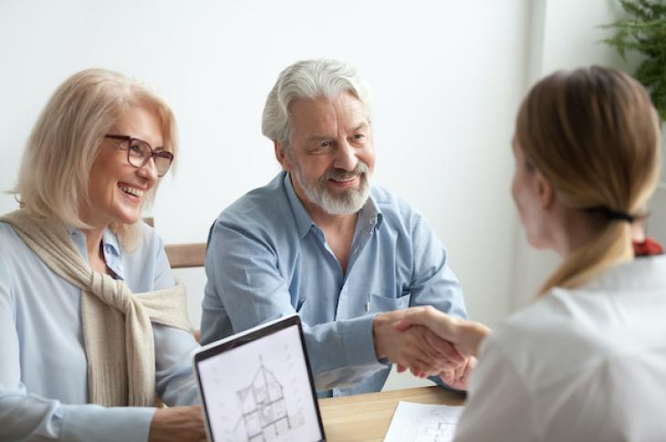 Older couple with real estate broker