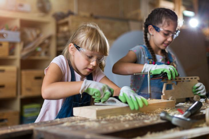 Two girls in a wood workshop