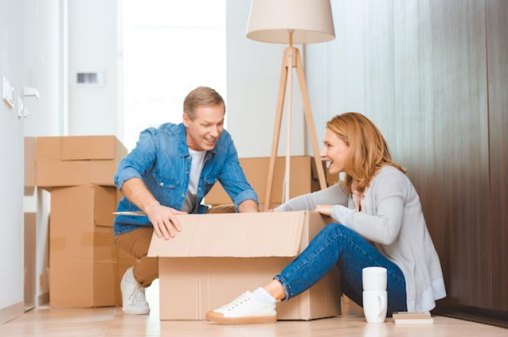 Couple packing moving boxes