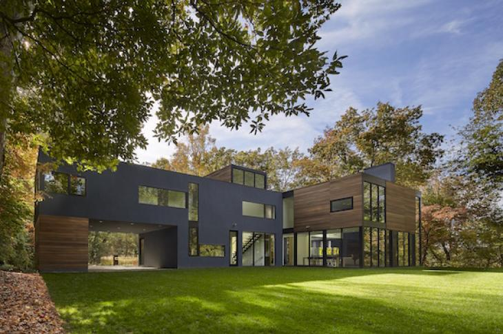Exterior shot of modern custom home in Maryland; wood, stucco and fiber cement siding