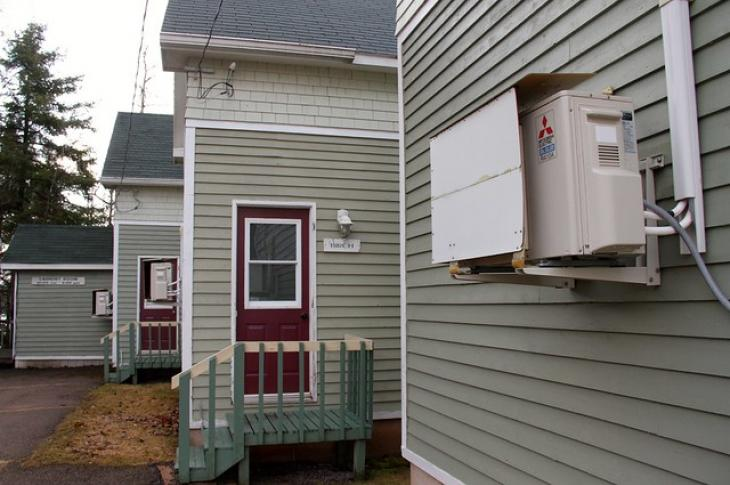 Heat-pump-installed-on-house-wall