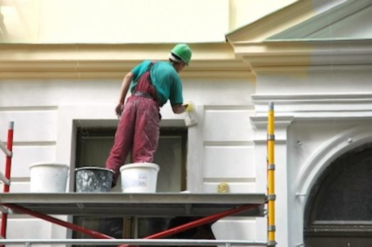 avoid waste in home building-better bottom line-worker-building facade-photo
